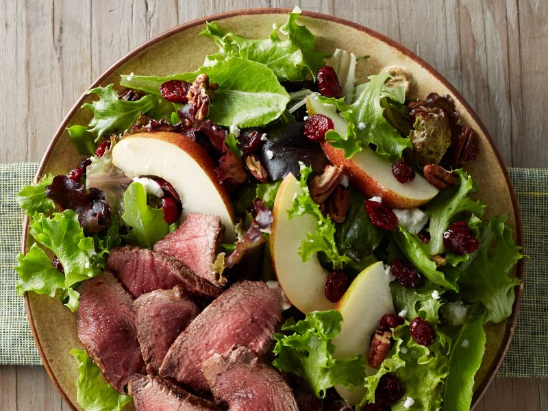 tenderloin-cranberry-and-pear-salad-with-honey-mustard-dressing-vertical-aerial